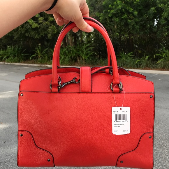 22c55f596d Coach mercer 30 in deep coral